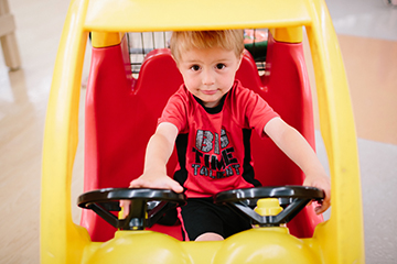 Child in toy car