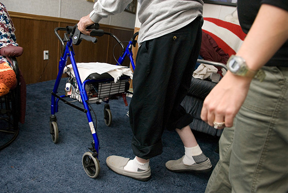 Wisconsin Care registered nurse Beth Wunderlin (wearing red) and physical therapist Beth Lee (wearing black) assess the physical abilities of Robert Kreil, 86, at Kreil's home in Madison, Wis., on Oct. 9, 2007. Wunderlin and Lee are following Sure Step, a falls-assessment and prevention program for patients created with the help of Jane Mahoney, a professor in the University of Wisconsin-Madison School of Medicine and Public Health. The program is now in use by nurses and health care workers in several counties throughout Wisconsin. ©UW-Madison University Communications 608/262-0067 Photo by: Jeff Miller Date: 10/07 File#: D200 digital camera frame 3984