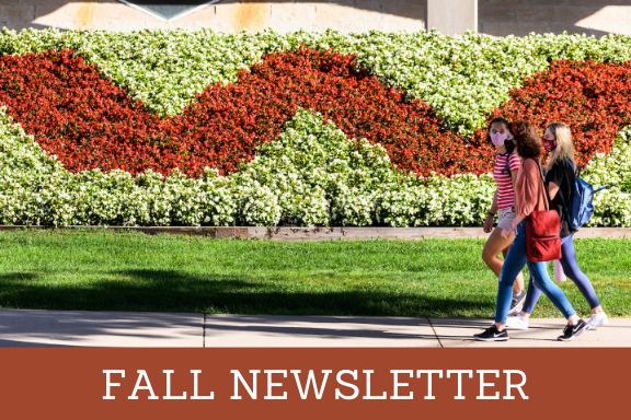 Fall newsletter - students walking in front of letter W made from flowers